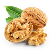 Walnuts with leaves isolated on white. With clipping path.