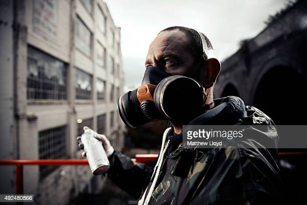Walsall born artist Title poses for a portrait during work on a six storey high artwork spray painted on the iconic Custard Factory on October 12...