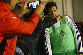 Walsall fans pose for a selfie photograph with substitute Eden Hazard of Chelsea during the Capital One Cup third round match between Walsall and...
