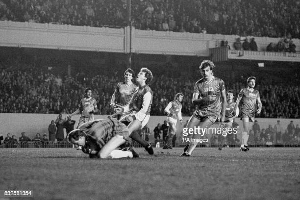 Walsall goalkeeper Mick Kearns saves under pressure from Arsenal's Tony Woodcock