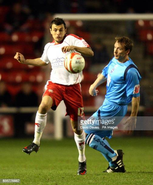 Walsall's Alex Nicholls gets away from Brighton Hove Albion's David Livermore during the CocaCola League One match at the Banks Stadium Walsall