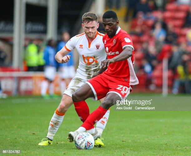 Walsall's Amadou Bakayoko holds off the challenge from Blackpool's Oliver Turton during the Sky Bet League One match between Walsall and Blackpool at...