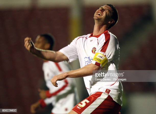 Walsall's Anthony Gerrard celebrates scoring their third goal of the game during the CocaCola League One match at the Banks Stadium Walsall