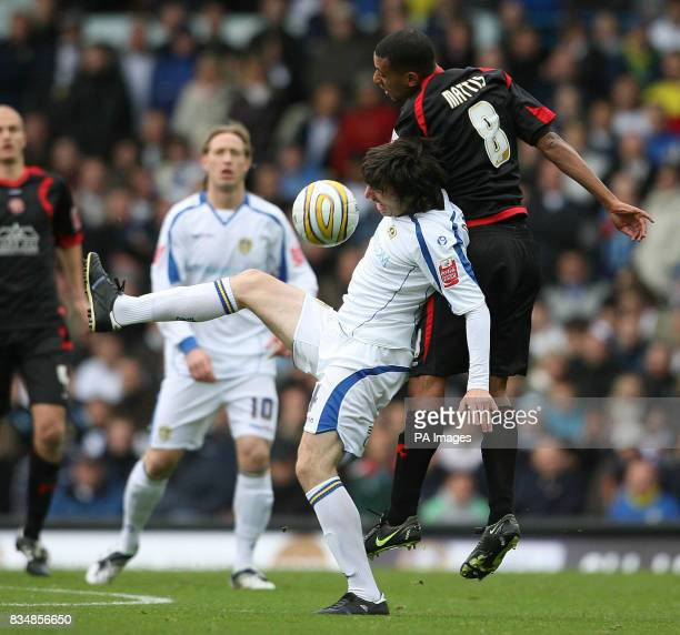 Walsall's Dwayne Mattis and Leeds United's Jonathan Douglas in action during the CocaCola League One match at Elland Road Leeds