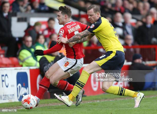 Walsall's goal scorer Tom Bradshaw and Fleetwood Town's Marcos Nilsson battle for the ball