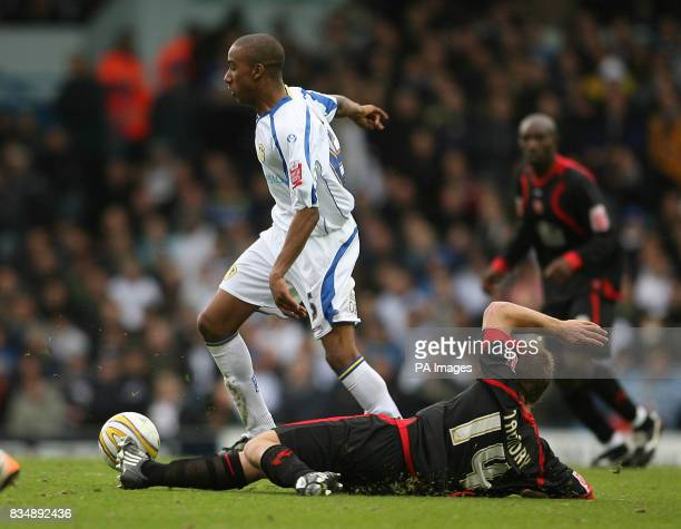 Walsall's Richard Taundry tackles Leeds United's Fabian Delph during the CocaCola League One match at Elland Road Leeds
