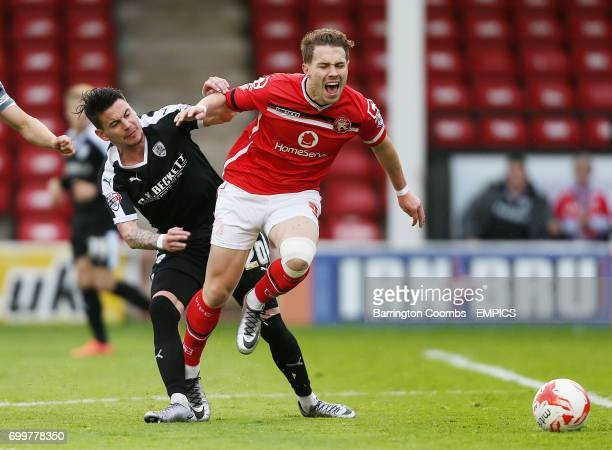 Walsall's Tom Bradshaw and Barnsley's Adam Hammill battle for the ball