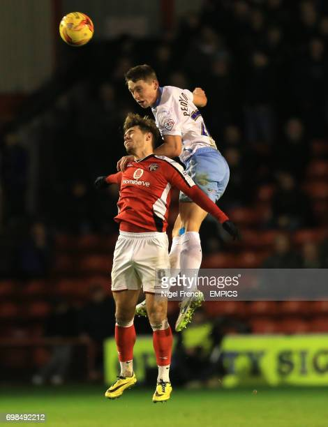 Walsall's Tom Bradshaw and Coventry City's Matthew Pennington battles for the ball