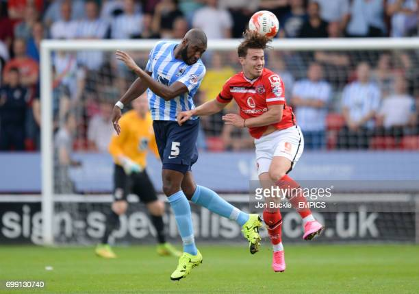 Walsall's Tom Bradshaw challenges Coventry Citys Reda Johnson