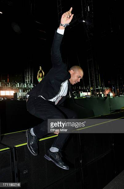 Walshy Fire of Major Lazer jumps off the stage as he performs at the 17th annual Electric Daisy Carnival at Las Vegas Motor Speedway on June 23 2013...