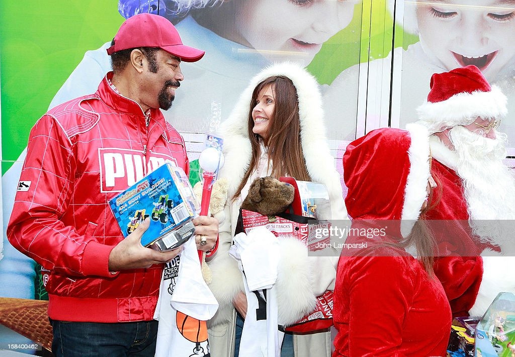 Walt 'Clyde' Frazier and Carol Alt attend The Police Athletic League And CitySights NY Holiday Party And Toy Drive at PAL's Harlem Center on December 15, 2012 in New York City.