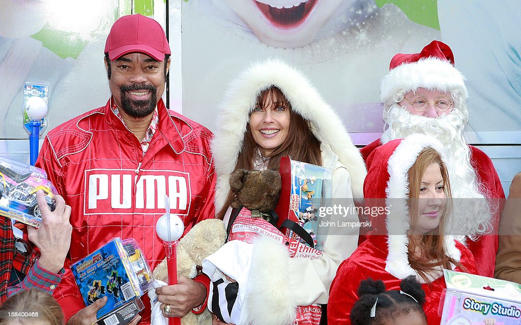 Walt 'Clyde' Frazier and <a gi-track='captionPersonalityLinkClicked' href=/galleries/search?phrase=Carol+Alt&family=editorial&specificpeople=202034 ng-click='$event.stopPropagation()'>Carol Alt</a> attend The Police Athletic League And CitySights NY Holiday Party And Toy Drive at PAL's Harlem Center on December 15, 2012 in New York City.