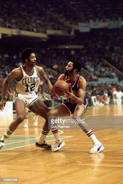 Walt 'Clyde' Frazier of the New York Knicks makes a move to the basket against the Boston Celtics during an NBA game circa 19671977 at the Boston...