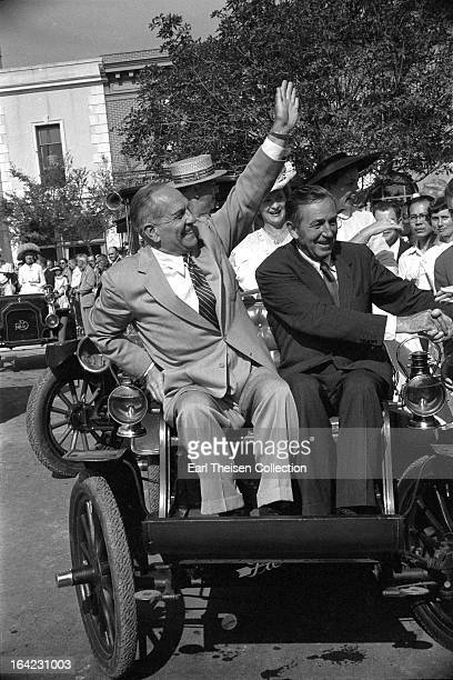 Walt Disney and California Governor Goodwin Knight ride an early PierceArrow on the opening day of Disneyland on July 15 1955 in Anaheim California