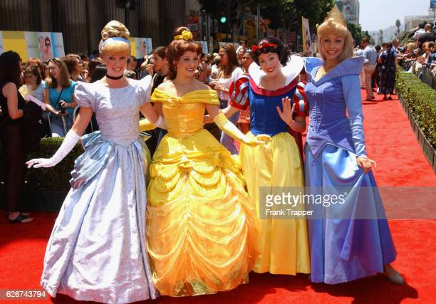 Walt Disney characters Cinderella Belle Snow White and Sleeping Beauty perform at the premiere of 'The Princess Diaries'
