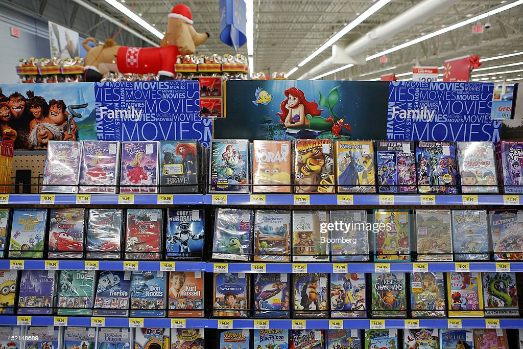 Walt Disney Co. movies are displayed for sale at a Wal-Mart Stores Inc. location ahead of Black Friday in Los Angeles, California, U.S., on Tuesday, Nov. 26, 2013. Wal-Mart Stores Inc. said Doug McMillon, head of its international business, will replace Mike Duke as chief executive officer when he retires as the world's largest retailer struggles to ignite growth at home and abroad. Photographer: Patrick T. Fallon/Bloomberg via Getty Images