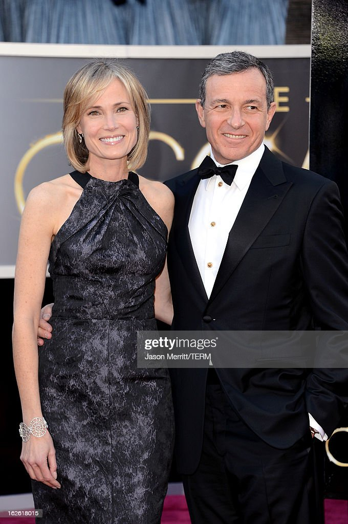 Walt Disney Company Chairman and CEO Robert Iger (R) and wife Willow Bay arrive at the Oscars at Hollywood & Highland Center on February 24, 2013 in Hollywood, California.