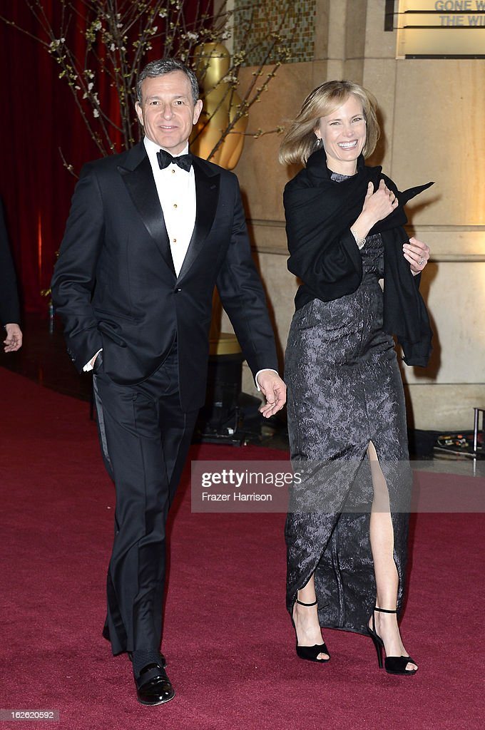 Walt Disney Company Chairman and CEO Robert Iger (L) and wife, Willow Bay, depart the Oscars at Hollywood & Highland Center on February 24, 2013 in Hollywood, California.