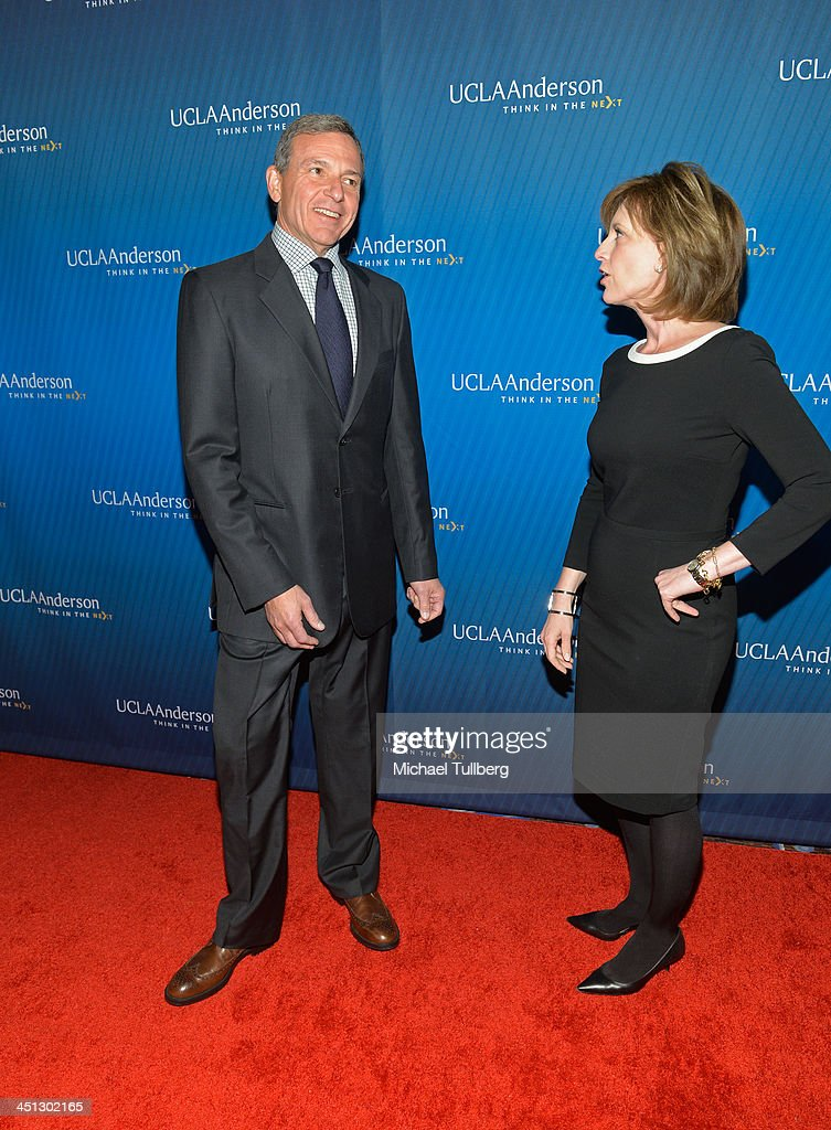 Walt Disney Company Chairman <a gi-track='captionPersonalityLinkClicked' href=/galleries/search?phrase=Bob+Iger&family=editorial&specificpeople=171211 ng-click='$event.stopPropagation()'>Bob Iger</a> and Disney Vice-President Ann Sweeney attend the 2013 Joh Wooden Global Leadership Awards hosted by the UCLA Anderson School of Management at The Beverly Hilton Hotel on November 21, 2013 in Beverly Hills, California.
