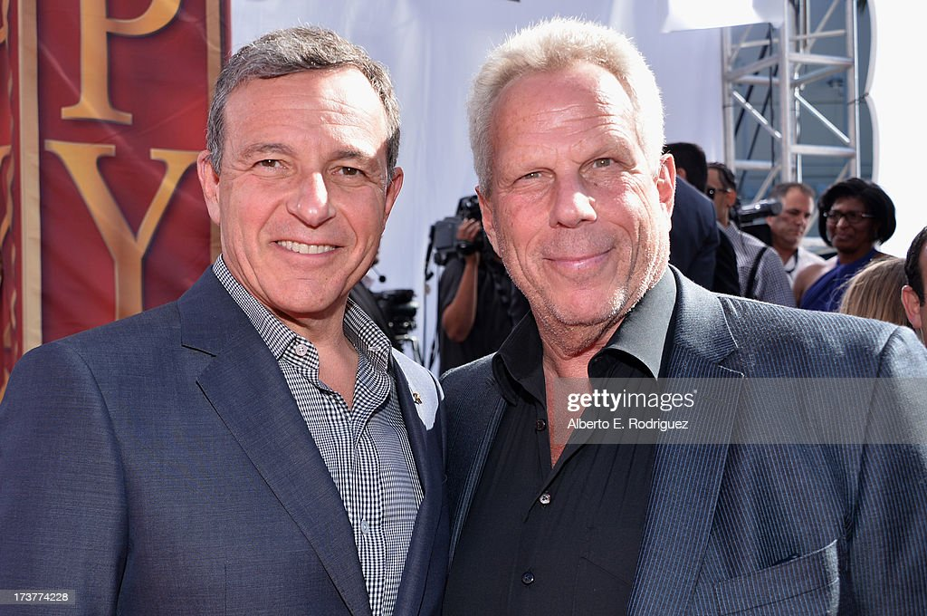 Walt Disney Company Chairman/CEO Bob Iger (L) and New York Giants chairman and EVP Steve Tisch attend The 2013 ESPY Awards at Nokia Theatre L.A. Live on July 17, 2013 in Los Angeles, California.