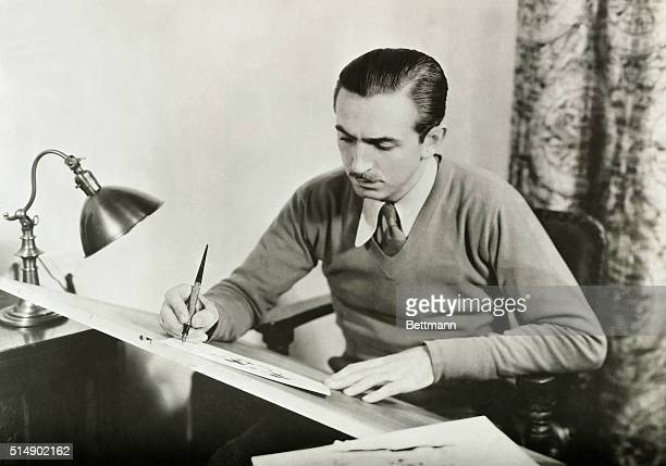 Walt Disney famed orignator of fulllength animated motion pictures at work at his drawing board