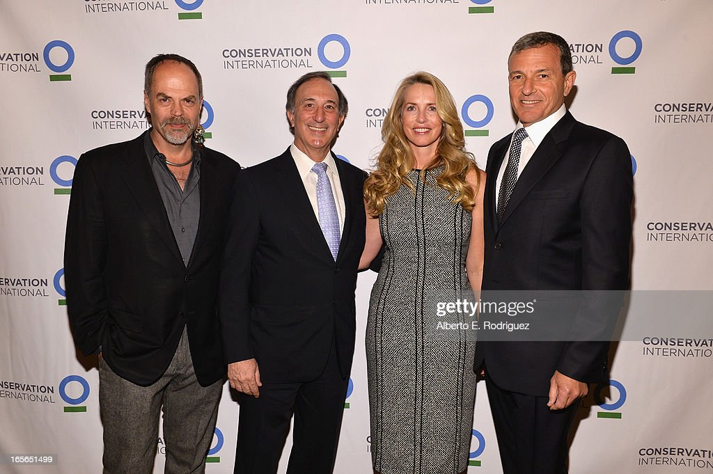 Walt Disney Imagineering executive Joe Rohde, Chairman and CEO of Conservation International Peter Seligmann, Laurene Powell Jobs and Chairman and CEO of The Walt Disney Company Bob Igerattend Conservation International's 17th Annual Los Angeles Dinner at Montage Beverly Hills on April 4, 2013 in Beverly Hills, California.