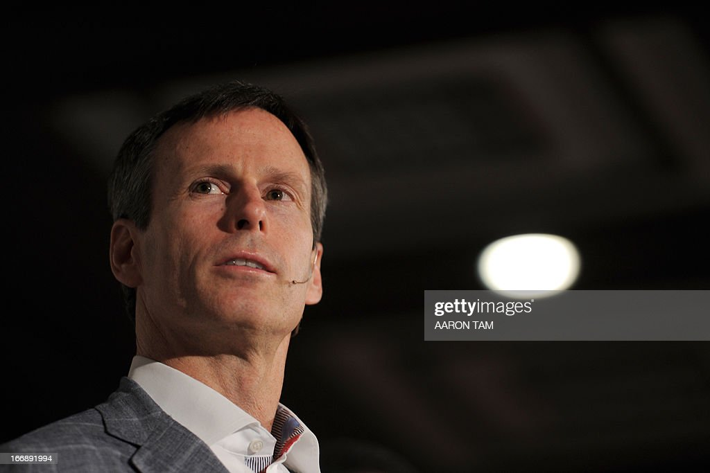 Walt Disney Parks and Resorts chairman Tom Staggs speaks to the press in Hong Kong during the unveiling of the new 'Mystic Point' attraction at the city's Disneyland on April 18, 2013. Hong Kong's once struggling Disneyland in February said it made a profit in 2012 for the first time since opening eight years ago, thanks to a surge in revenue as it welcomed a record number of visitors. AFP PHOTO / AARON TAM