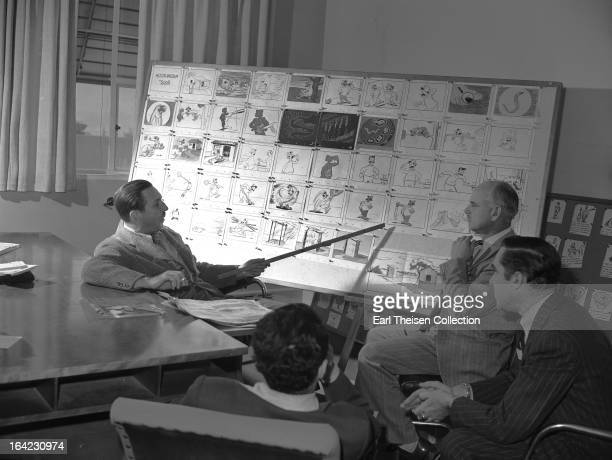 Walt Disney points to a storyboard for the commisioned animated short 'Hookworm' circa 1945 in Los Angeles California
