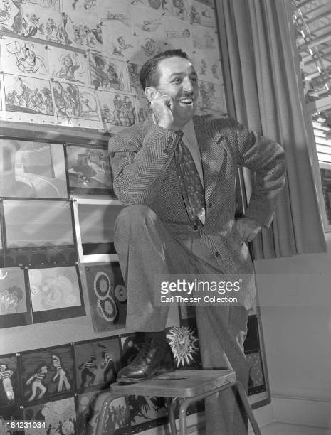 Walt Disney poses for a portrait next to a Donald Duck storyboard circa 1945 in Los Angeles California