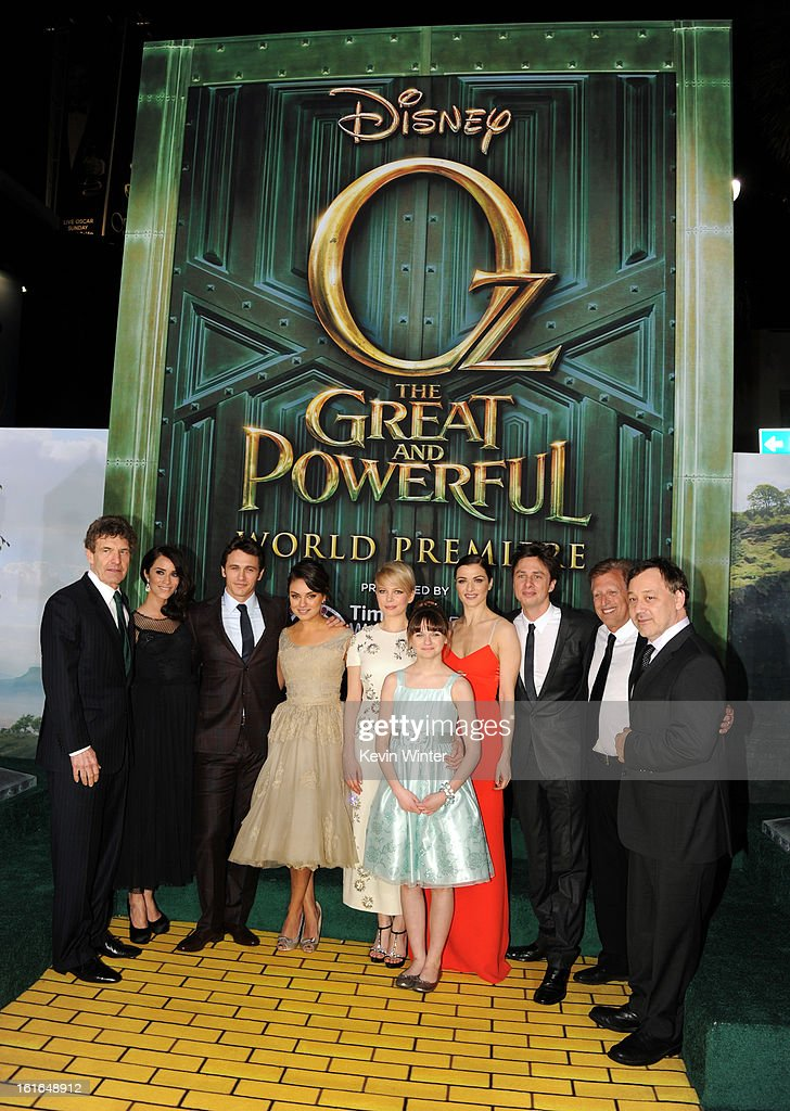 Walt Disney Studios Chairman Alan Horn, actors Abigail Spencer, James Franco, Mila Kunis, Michelle Williams, Joey King, Rachel Weisz, Zach Braff, Producer Joe Roth and Director Sam Raimi attend the world premiere of Walt Disney Pictures' 'Oz The Great And Powerful' at the El Capitan Theatre on February 13, 2013 in Hollywood, California.