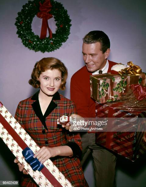 Noreen Corcoran and John Forsythe in Christmas layout 12/19/61