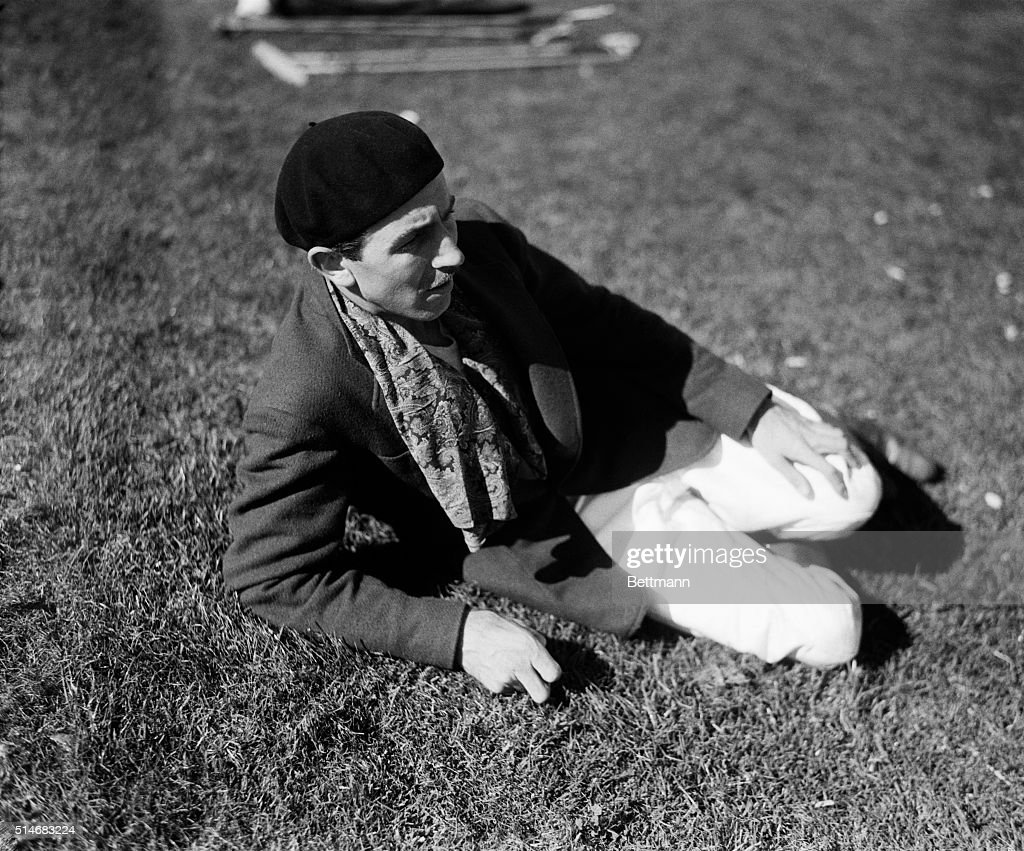 Walt Disney the American entrepreneur reclines on the lawn of the Riviera Country Club on June 21 and watches the polo match between the Greyhounds...