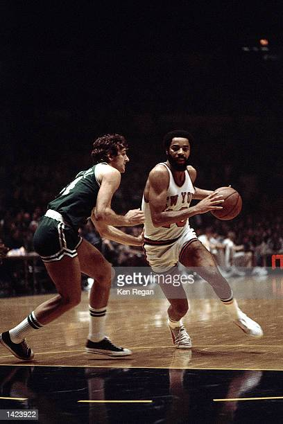 Walt Frazier of the New York Knicks drives to the basket against the Boston Celtics during the NBA game at Madison Square Garden in New York New York...