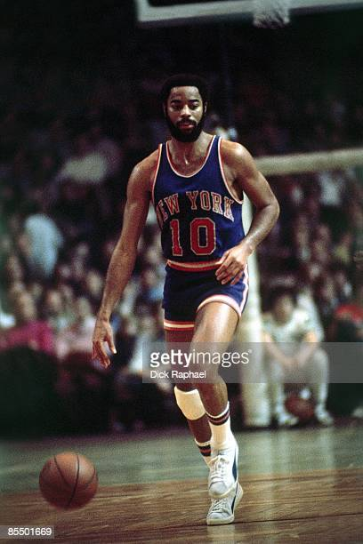 Walt Frazier of the New York Knicks moves the ball up court against the Boston Celtics during a game played in 1973 at the Boston Garden in Boston...