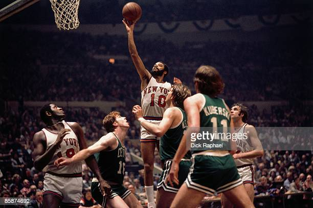 Walt Frazier of the New York Knicks shoots a layup against the Boston Celtics during the Eastern Conference Finals played in 1973 at Madison Square...