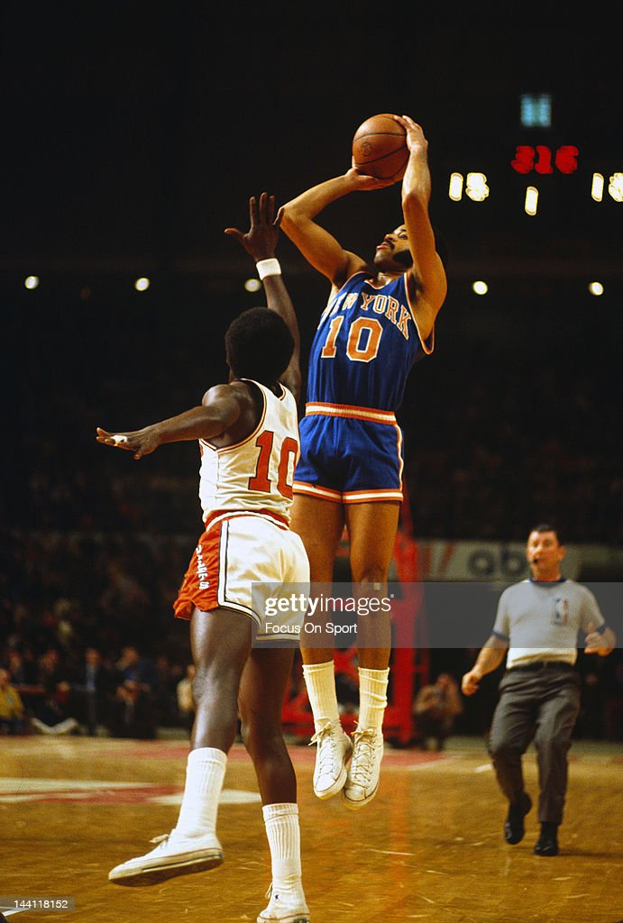 Walt Frazier of the New York Knicks shoots over Earl Monroe of the Baltimore Bullets during an NBA basketball game circa 1970 at the Baltimore Civic...