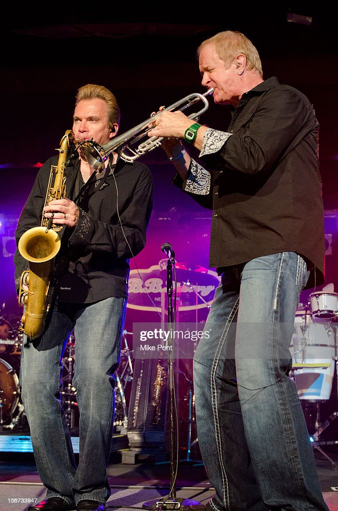 Walt Parazaider and Lee Loughnane of the rock band Chicago performs during the Musician's On Call 2012 Benefit at B.B. King Blues Club & Grill on November 19, 2012 in New York City.