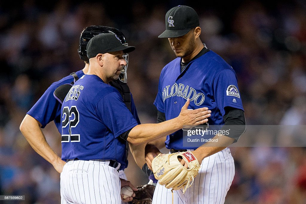 Walt Weiss #22 of the Colorado Rockies relieves Carlos Estevez #54 in the ninth inning of a game against the Texas Rangers after Esteves gave up 2 runs to tie the game at Coors Field on August 8, 2016 in Denver, Colorado.