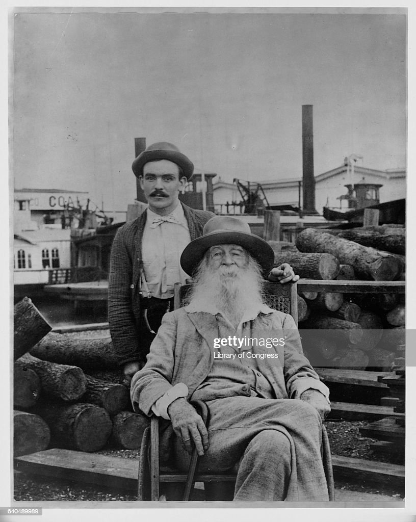 Walt Whitman sits with his nurse, Warren Fritzenger, on a wharf near his house, 1890. | Location: Mickie Street, Camden, New Jersey, USA.