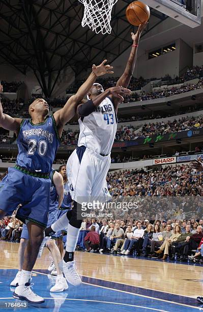 Walt Williams of the Dallas Mavericks drives to the basket against Gary Trent of the Minnesota Timberwolves during the game at American Airlines...