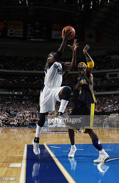 Walt Williams of the Dallas Mavericks drives to the basket during the NBA game against the Indiana Pacers at American Airlines Center on December 17...