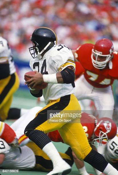 Walter Abercrombie of the Pittsburgh Steelers carries the ball against the Kansas City Chiefs during an NFL football game November 10 1985 at...