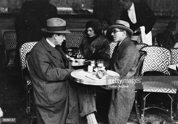 Walter Adolf Gropius the German born American architect his wife and Le Corbusier at the 'Cafe des Deux Magots' in Paris