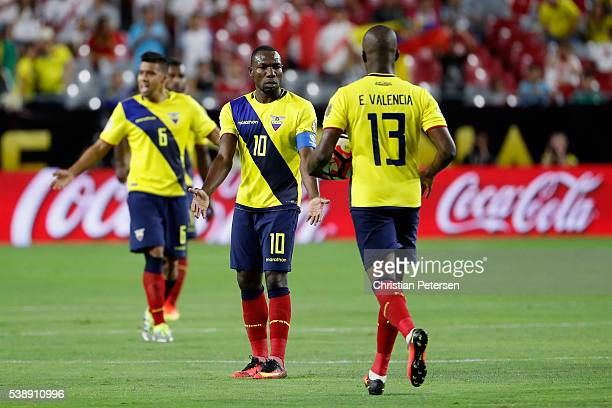Walter Ayovi of Ecuador highfives Enner Valencia after Valencia scored a goal against the Peru during the first half of the 2016 Copa America...