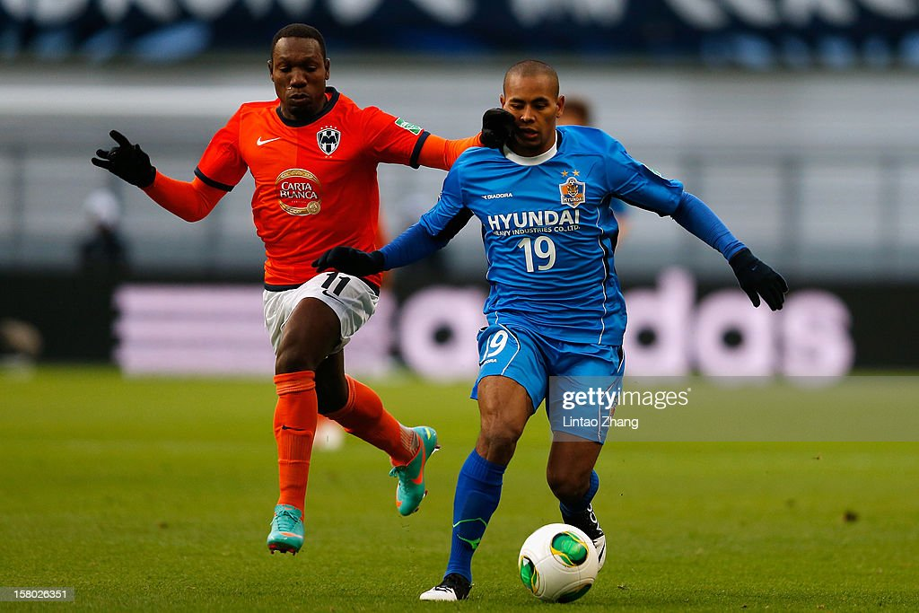 Walter Ayovi (L) of Monterrey challenges Rafinha (R) of Ulsan Hyundai during the FIFA Club World Cup Quarter Final match between Ulsan Hyundai and CF Monterrey at Toyota Stadium on December 9, 2012 in Toyota, Japan.