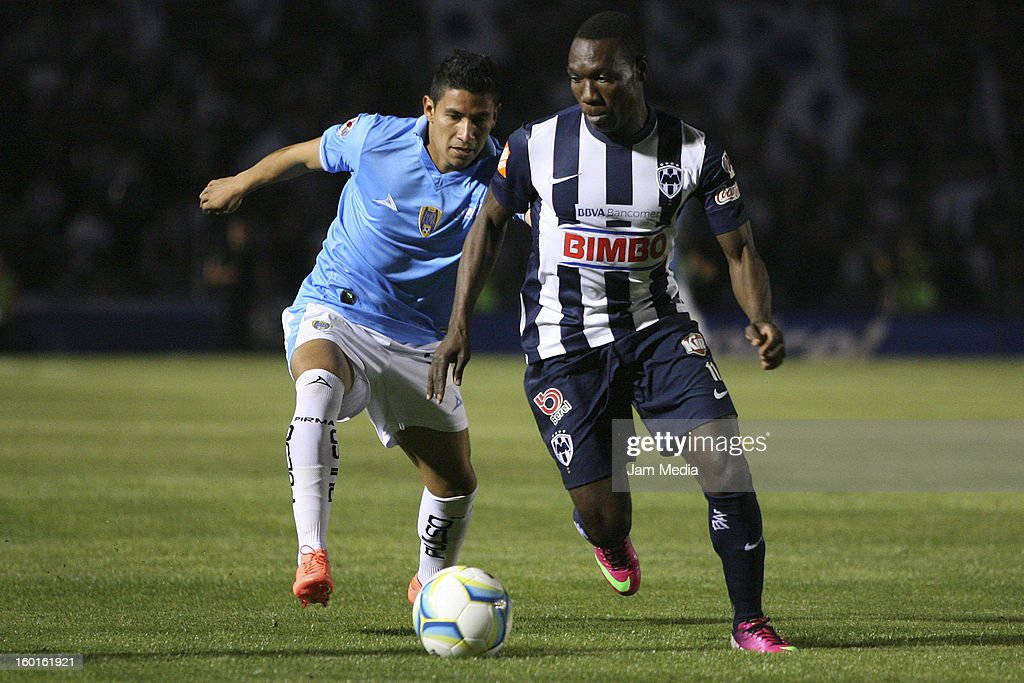 Walter Ayovi (R) of Monterrey struggles for the ball with Orlando Rincon (L) of San Luis during a match between Monterrey v San Luis as part of the Clausura 2013 Liga MX at Tecnologico Stadium on January 26, 2013 in Monterrey, Mexico.