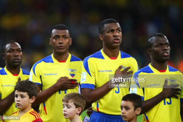 Walter Ayovi Oswaldo Minda Frickson Erazo and Enner Valencia of Ecuador sing the National Anthem prior to the 2014 FIFA World Cup Brazil Group E...