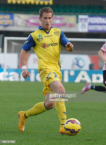 Walter Birsa of Chievo competes for the ball with Emmanuel Cascione of Cesena during the Serie A match between AC Chievo Verona and AC Cesena at...