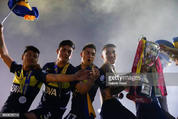 Walter Bou Jonathan Silva Nazareno Solis and Ricardo Centurion of Boca Juniors lift the champions trophy to celebrate after a match between Boca...