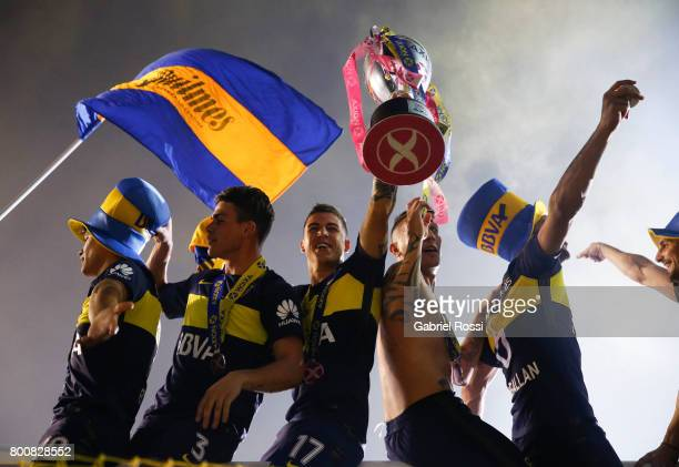 Walter Bou Jonathan Silva Nazareno Solis Ricardo Centurion and Lisandro Magallan of Boca Juniors lift the champions trophy to celebrate after a match...